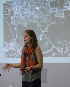 Ashton Rohmer of UNC-Chapel Hill, organizer of the event and Coastal Resilience Center Career Development Grant recipient, presents on her master's project at the Triangle Resilience Student Research Symposium.