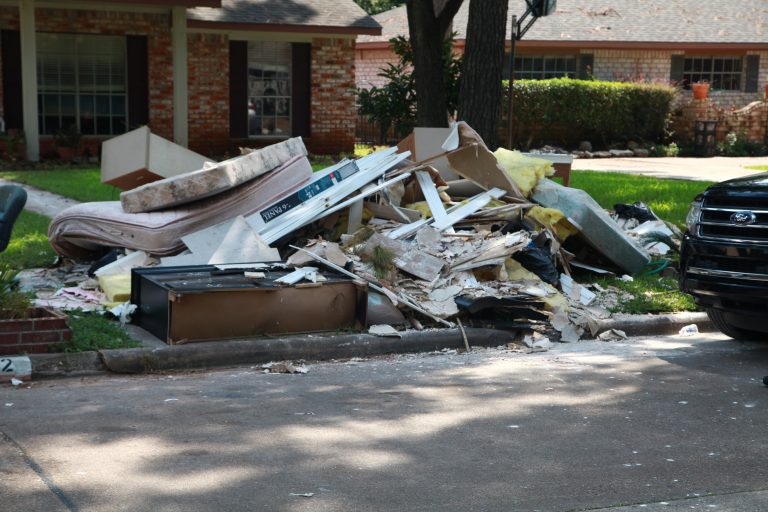 Debris on the side of the road in a Houston area neighborhood affected by Hurricane Harvey. Photo courtesy of FEMA.