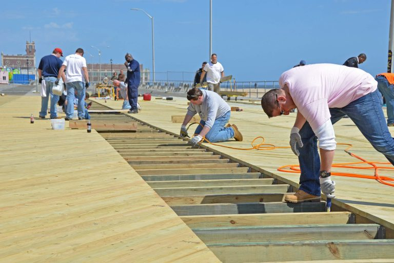 In an example of recovery, the Asbury Park, N.J. boardwalk is partially rebuilt by employees of Pepsi of Asbury Park as well as some colleagues from other locations of PepsiCo after Hurricane Sandy hit the area in 2012. Photo by Sharon Karr/FEMA