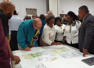 Design Team member Kofi Boone, far right, and Princeville, N.C., Mayor Pro Tem Linda Joyner, second from right, discuss plans for a proposed expansion of Princeville, N.C., with residents.