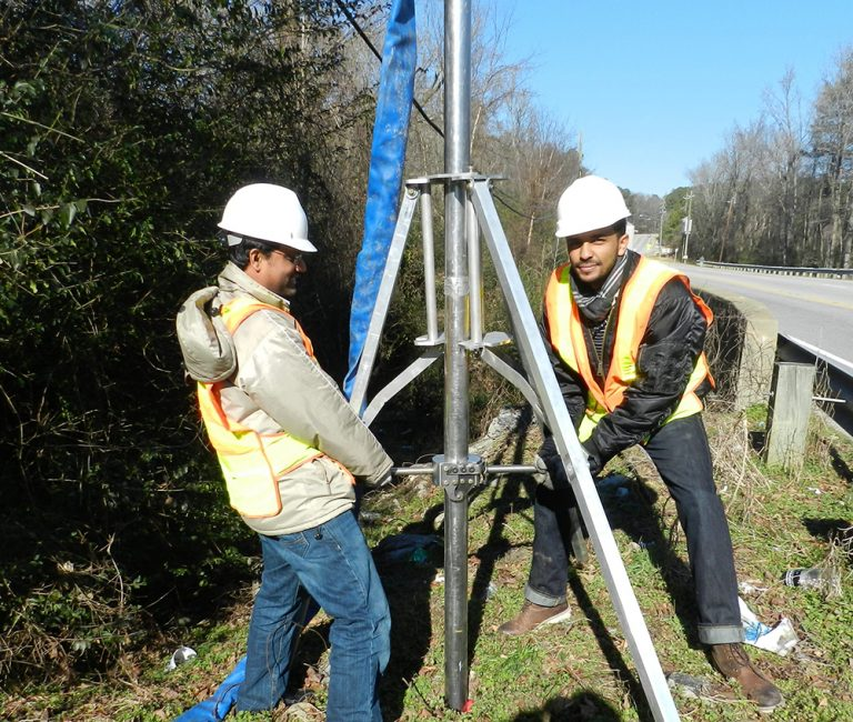 Mohammad Kayser, left, and Yulian Kebede, students of Dr. Gabr at North Carolina State University funded by the Coastal Resilience Center, test the in-situ erosion evaluation probe.