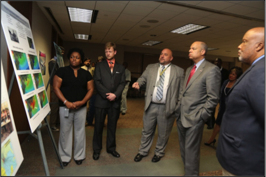 From left: Nakarsha Bester, Donald Hendon and Chris Herron explain storm surge scenarios to former Department of Homeland Security Secretary Jeh Johnson and U.S. Rep. Bennie Thompson of Mississippi's 2nd District, at Jackson State University. Bester, Hendon and Herron all received master's degrees in Engineering (Coastal Engineering concentration) as part of the JSU program.
