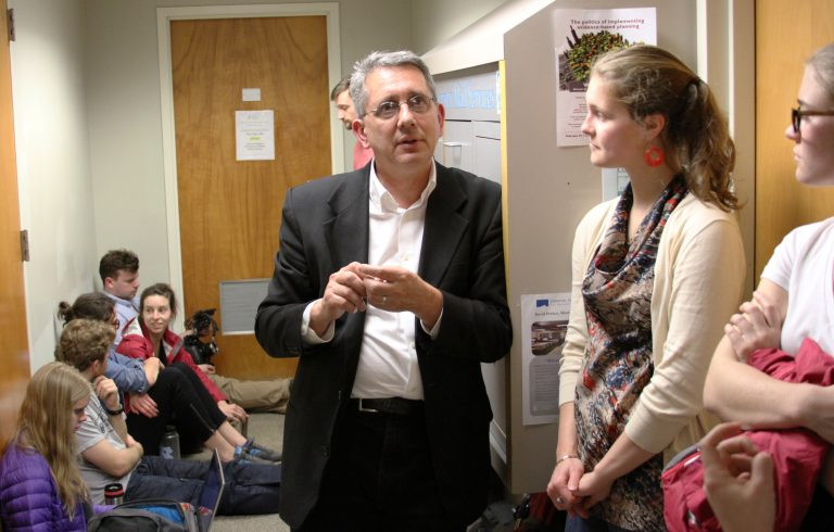 "David Perkes shelters in place during a tornado warning at UNC-Chapel Hill and speaks with students before his public talk on Feb. 24, 2016. Perkes spoke on ""Disasters and Design."""