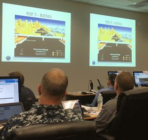Participants in the training view simulations of hypothetical storm impacts on Rhode Island. Photo submitted by the University of Rhode Island.