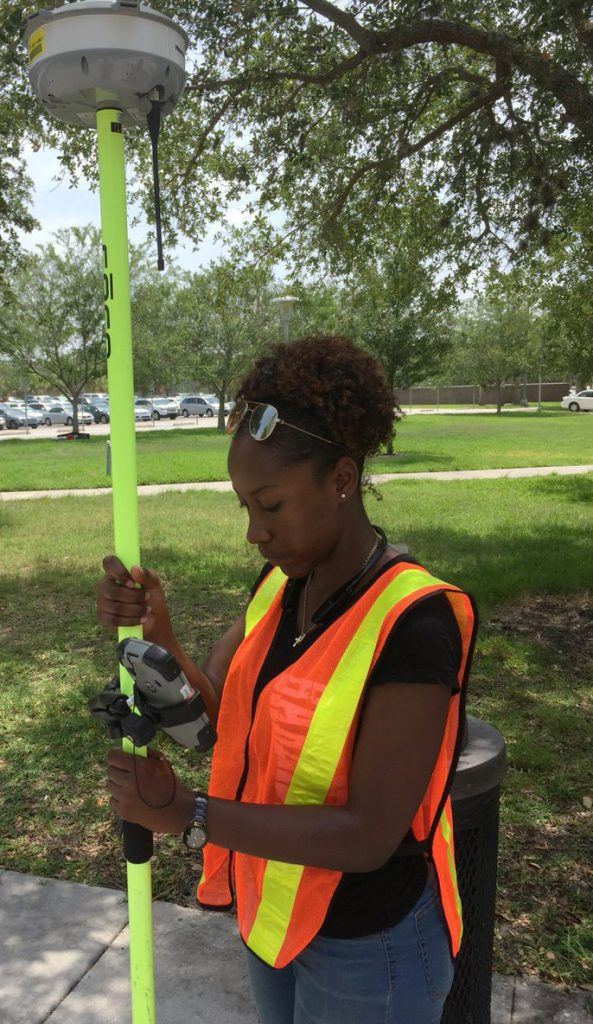Sabrina Welch of Jackson State University learns about surveying at the University of Central Florida as part of the CRC's SUMREX program. Photo by Dr. Stephen Medeiros.