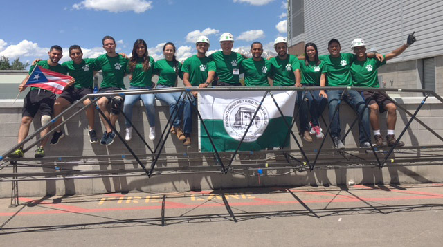 Students from UPR-M pose with their steel bridge from the national competition.