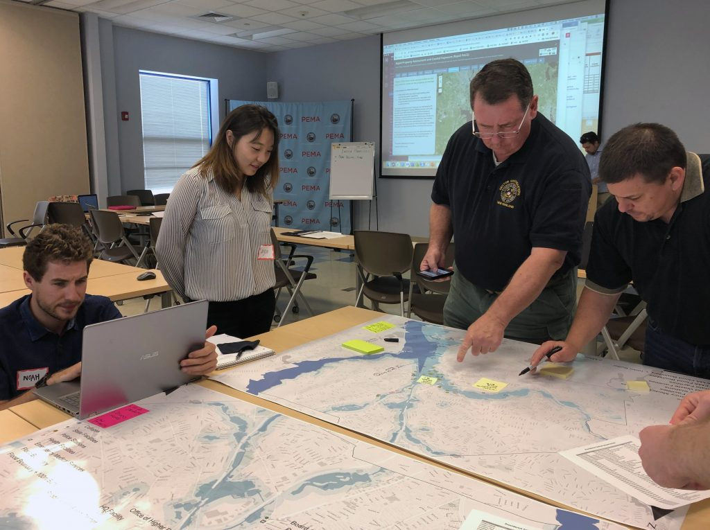 Representatives of Rhode Island emergency management agencies, along with government and public health departments met with University of Rhode Island researchers for training exercises this summer. Photo submitted.